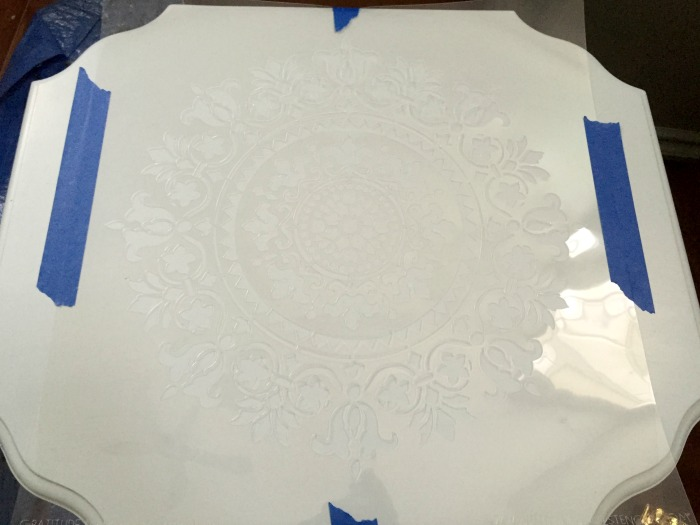 Two tier table painted in Blue Lace and stencilled with a mandala stencil.